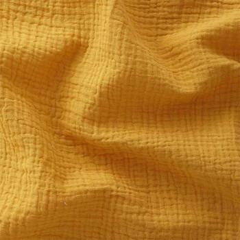 Tissu double gaze gaufrée de coton uni moutarde 130 cm
