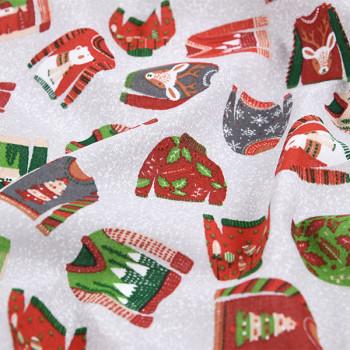Tissu toile multicolore imprimé pull de Noël