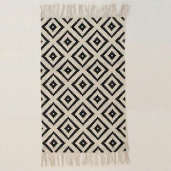 Tapis motif losange blanc et noir à franges 50 x 80 cm