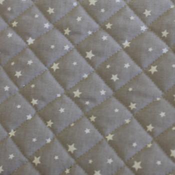 Tissu coton matelassé imprimé étoiles gris 150 cm