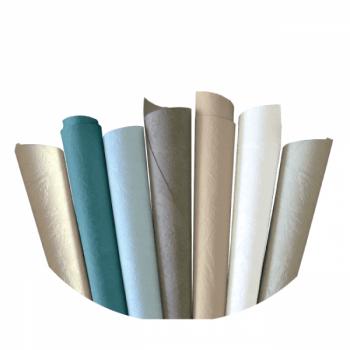 Papier peint vinyle lessivable effet taloché bleu canard mat