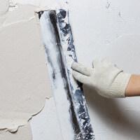 Sous couche, enduit et toile de rénovation