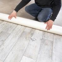 Sous-couche et outil d'aide à la pose de sol en pvc